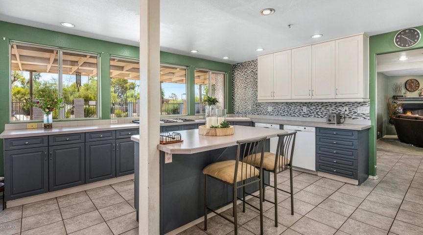 Open and inviting kitchen with backyard views and a ton of natural light.