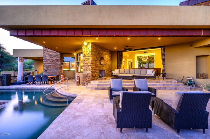 Multiple sitting areas to entertain with L shaped pool surround one side of patio, cozy fire place, BBQ grill and separate stand alone spa.