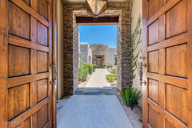 Front Entry to Courtyard with Front Door in distance.