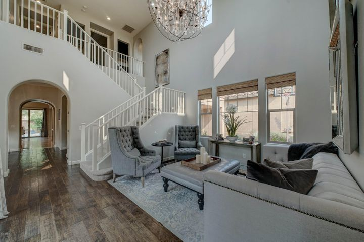 Gorgeous entry with beautiful chandelier and lots of natural light.