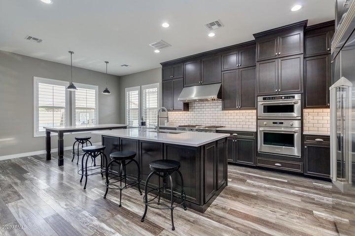 Kitchen with custom Monogram appliances and quartz counters