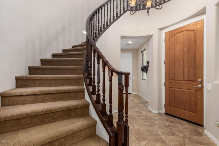 Gorgeous staircase with wood railing