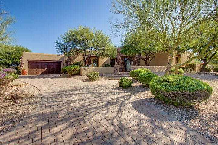 Gorgeous circular drive entering your this stunning custom home sitting on 1-acre
