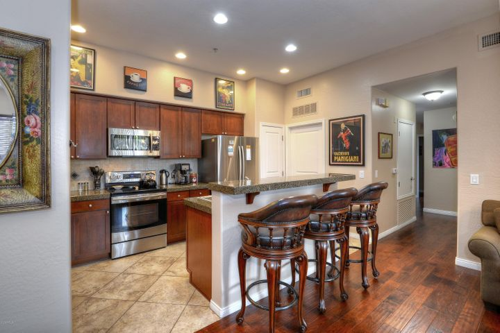 Kitchen offers plenty of light and breakfast bar.