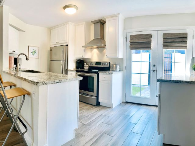 French Doors Lead From Kitchen to Stunning Back Patio