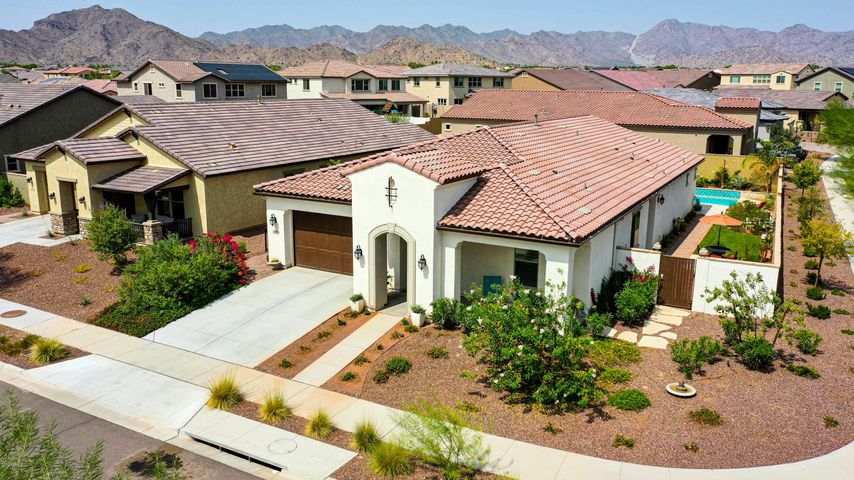 Just over two years new, this corner lot Spanish Colonial has unobstructed views of the Estrella Mountains.