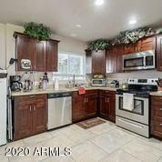 Updated kitchen with granite counters and beautiful cabinets