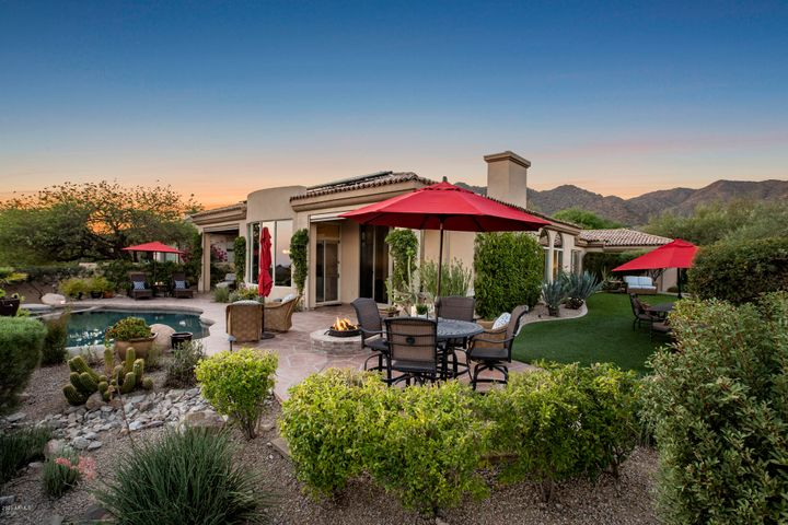 Ahhhmazing backyard for entertaining, family fun times or just relaxing... ahead of you here. Both cover patios include motorized sunscreens.