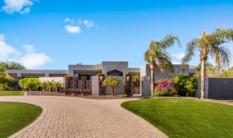Welcome home to this custom built contemporary masterpiece.