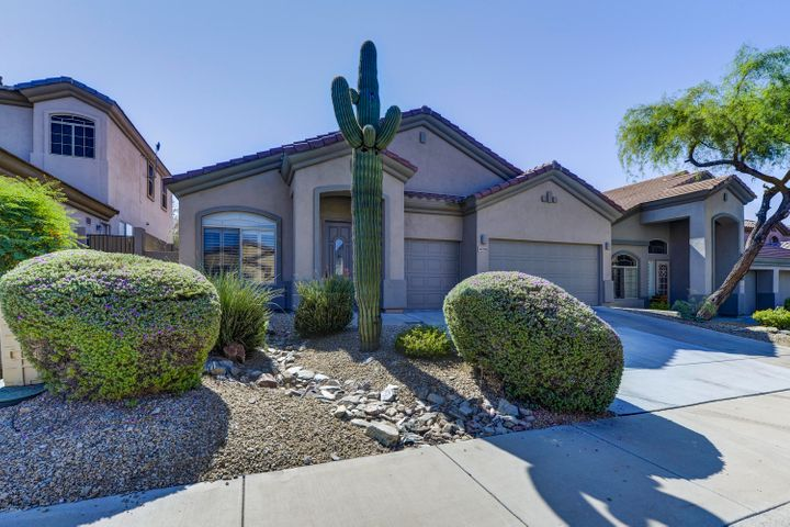 Welcome to 10339 E Acoma Dr situated on the golf course in McDowell Mountain Ranch.