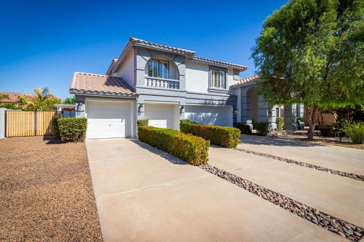 This unique 5 bedroom/3.5 bath home has been newly painted and is move-in ready!