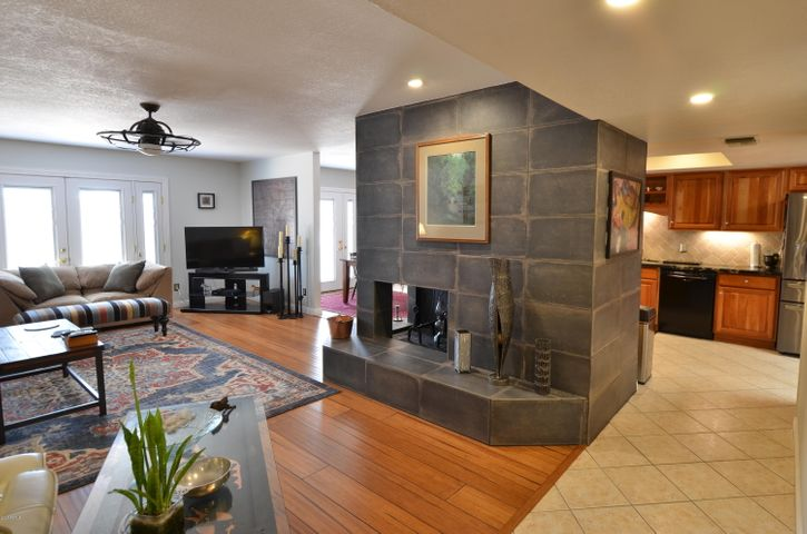 Living room, Fireplace & Kitchen