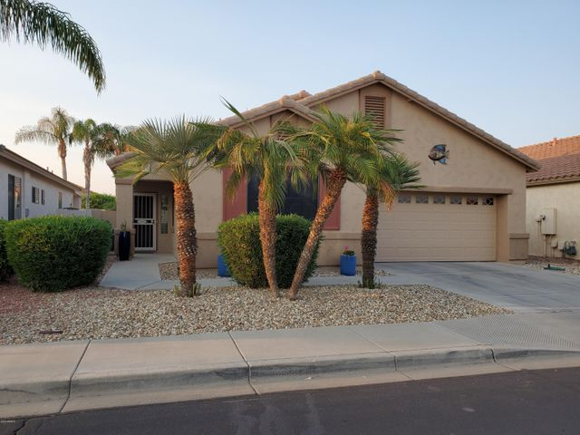 This lovely home is located in the guard-gated 55+ resort community of Arizona Traditions.