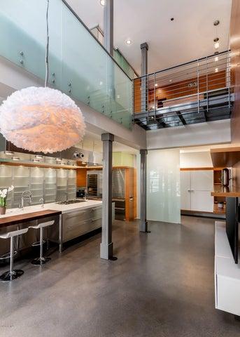 Concrete floor, vertical grain fir planks, translucent glass railings and partitions.