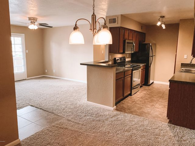 Kitchen View from Dining Room + into Living Room