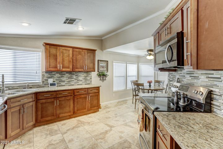 unbeilievable kitchen with all granite and stainless steel applicances