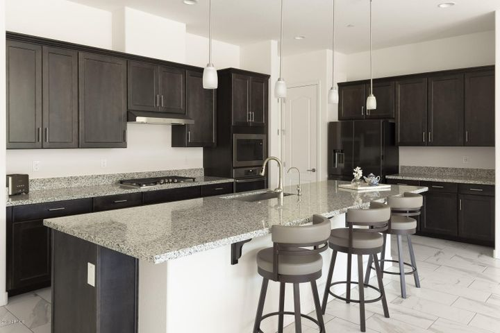 Kitchen features a breakfast bar, granite counters, and gas stove top.
