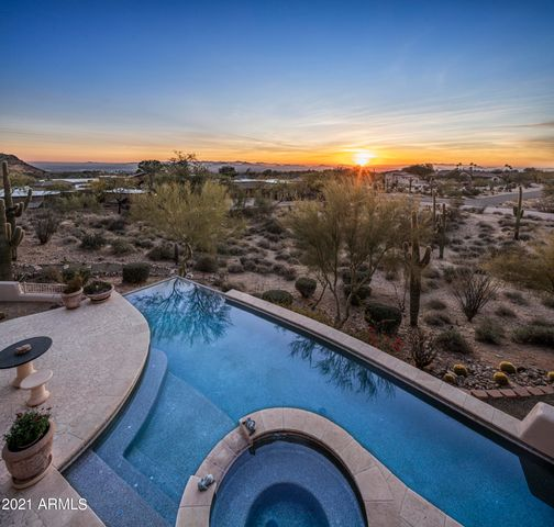 Enjoy Sunsets, City Lights and Mountain Views from this custom estate.
