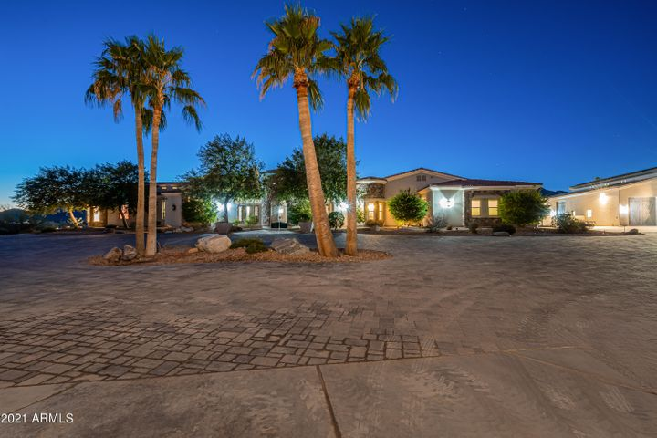 Your royal motor court that rounds an island landscaped with palm trees for carriage parking