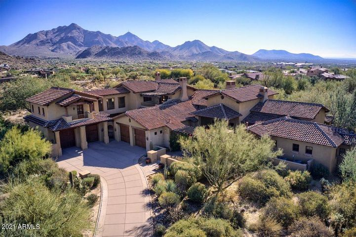 This desert retreat offers 5 bedrooms, 6 bathrooms, 4 garage stalls and includes formal theatre room, two bonus rooms and a detached casita.