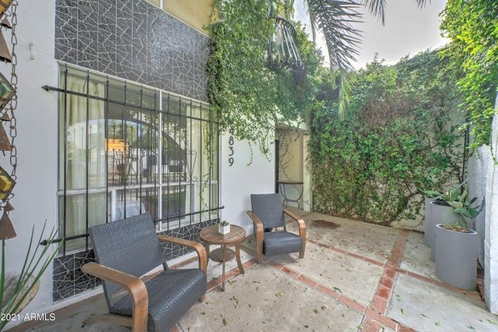 Private front patio is a perfect place to read the morning paper or partake of the neighborhood happy hour.