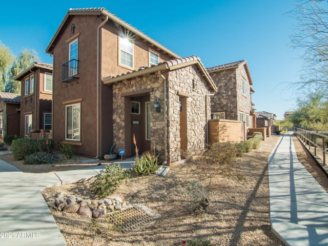 Prime end unit situated on a corner lot with easy access to walking trails.