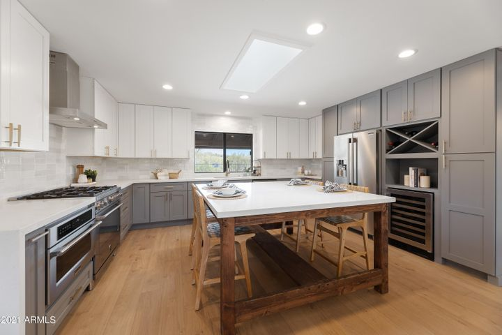 """Kitchen with 42"""" upper cabinets and large custom island"""