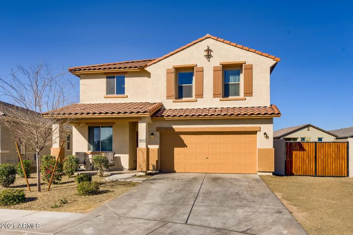 Lot's of curb appeal and highly desirable three car garage and RV gates!