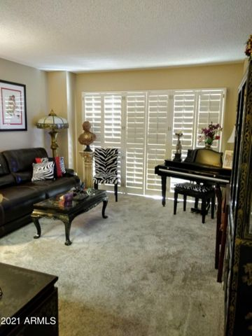 Nice living room with plantation shutters in this cute 1BR, 1BA condo with a great location.