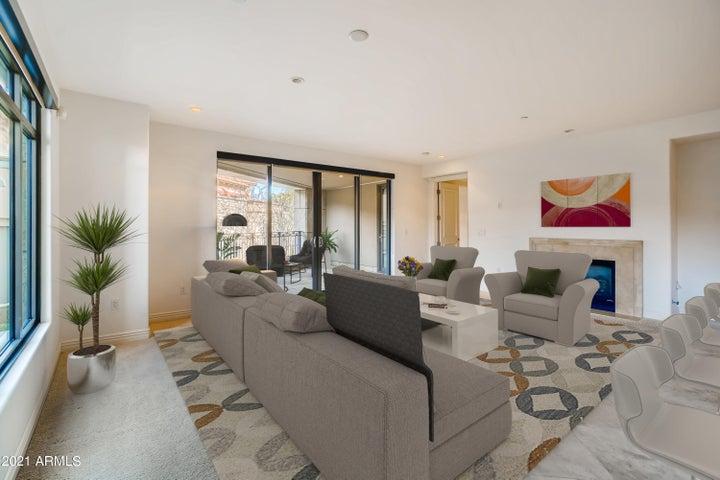 Open Living Room reveals adjacent balcony (staged)
