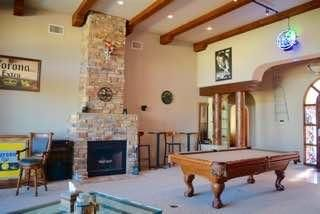 Great Room has 14' wood beamed ceilings, impressive wood accents, floor to ceiling fireplace, and big open views!