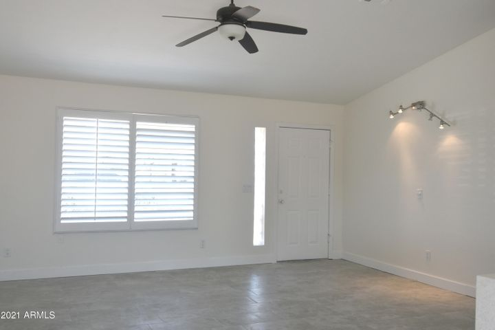 Family Room with Plantation Shutters and opens to Dining Room.