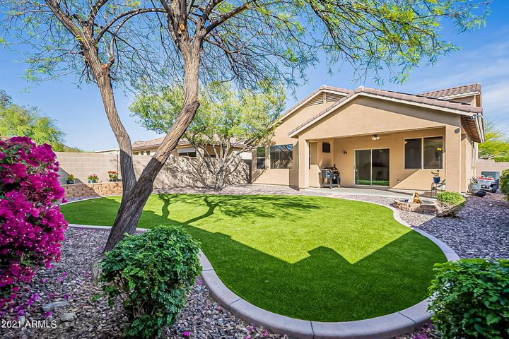 This gorgeous artificial turf was installed in 2020 and has a built-in sprinkler system. Ask most homeowners with turf if they can walk on their lawn in the AZ summers. THIS ONE, thanks for the sprinkler system, is a game-changer. Pet and kid-friendly turf in AZ. WOW!