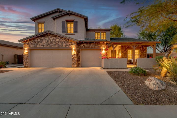 Beautiful curb appeal with 3 car garage and stone accents