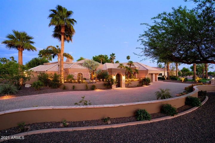 Impressive entry into private courtyard with large seating area . Entire drive and courtyard have beautiful pavers.