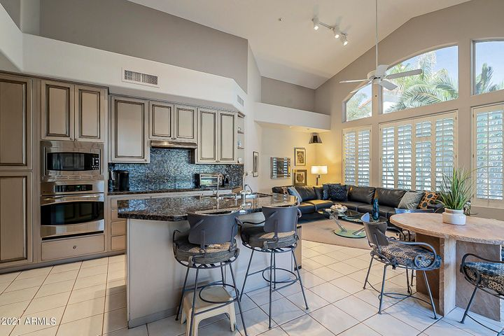 Updated kitchen is open to family room and casual dining area