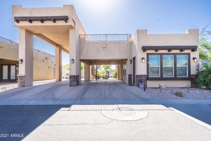 Santa Fe Casita with covered RV port with full hook ups, covered carport, back patio and view deck.