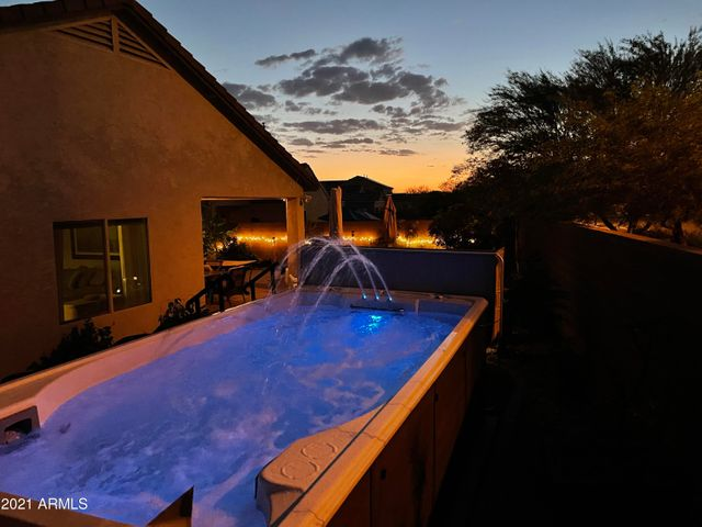 Spectacular views of sunset from the swim spa. The spa offers different color choices for whatever mood you are in!
