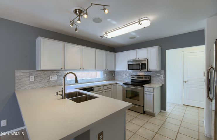 Totally Remodeled Kitchen with Extended Quart Countertops | Stainless Appliances and Lighting