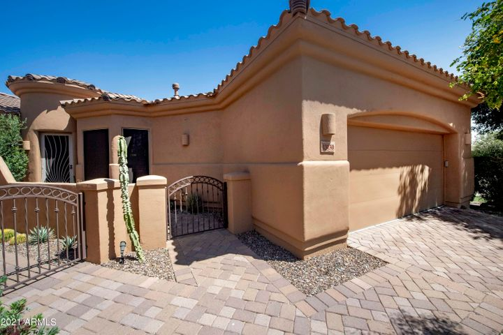 Attractive paver driveways and gated courtyard entry