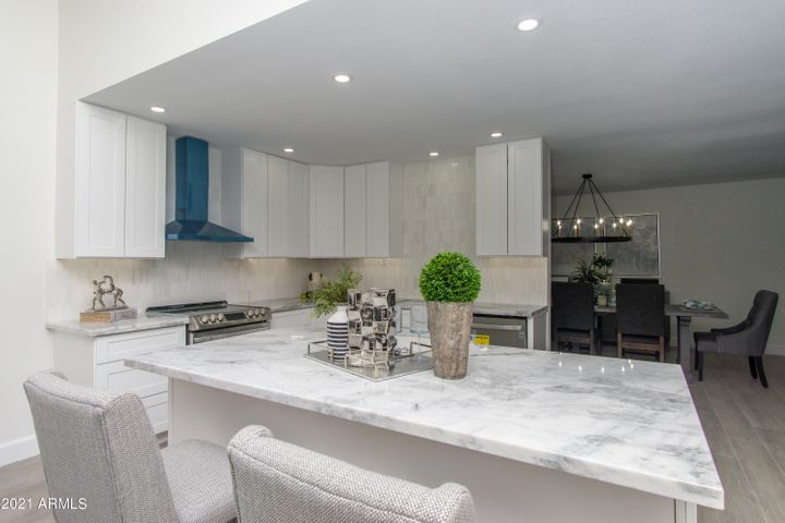 New Cabinets, Appliances, Marble Counters, Island and Backsplash. Please note: Range hood has protective plastic wrap on stainless hood that will be removed prior to COE.