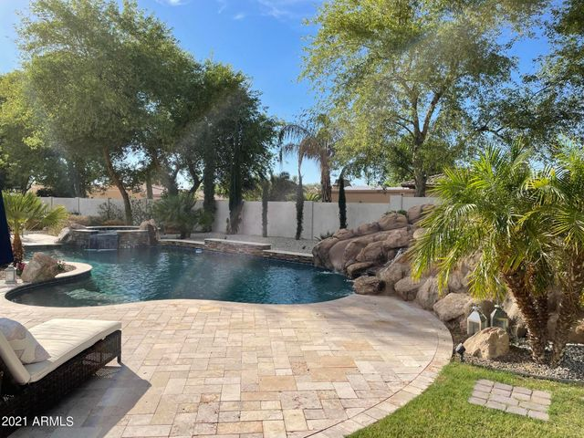 Enjoy the refreshing POOL, Slide, and SPA surrounded by tropical and low maintenance plants. Pro pics coming soon!