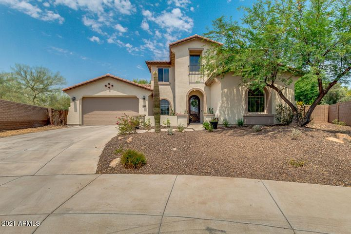 Beautiful curb appeal with long driveway and fresh rock landscaping