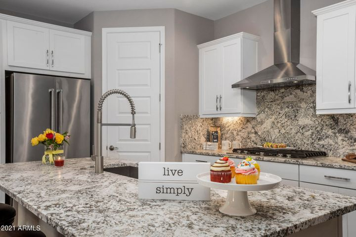 Gourmet kitchen with leather quartz counter tops