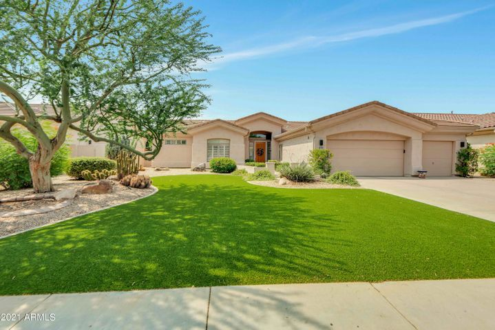 This beautiful home has artificial turf for low maintenance.