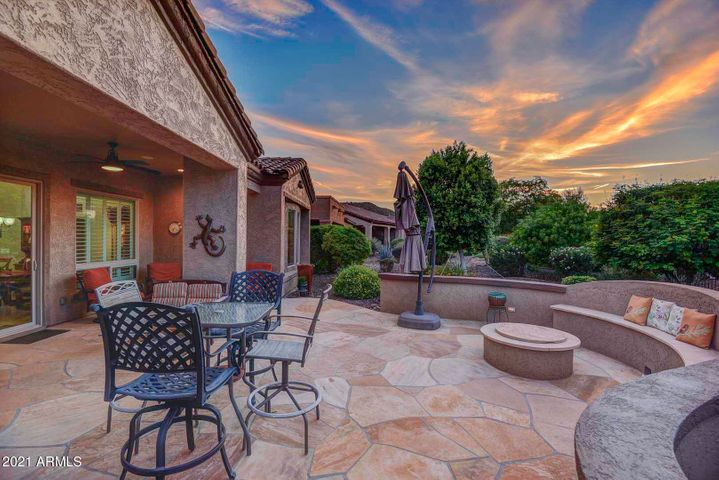 Beautiful outdoor paradise with extended patio, firepit with built-in seating, and BBQ