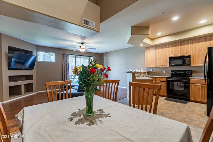 Open Concept Great Room with Dining, Kitchen, Family Rm w/Patio