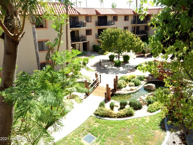 Beautiful Koi Pond courtyard view from your balcony!