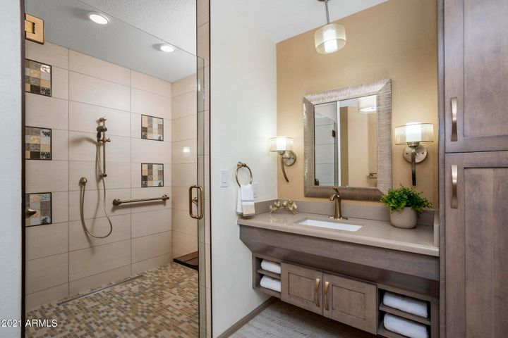 The downstairs Master Suite was expanded and upgraded with ADA Friendly Finishes including wider hallways, doors, wheelchair friendly vanities and zero entry walk-in shower with folding bench.