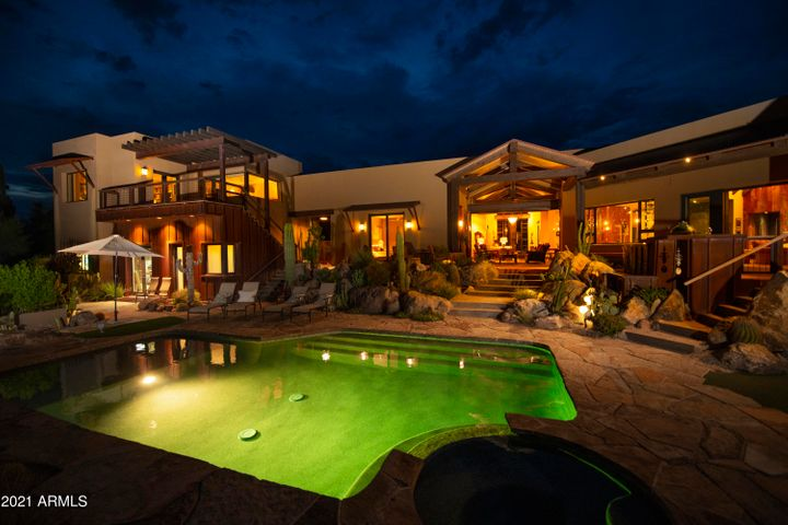 Stunning night views of pool, ramada, home and casita.
